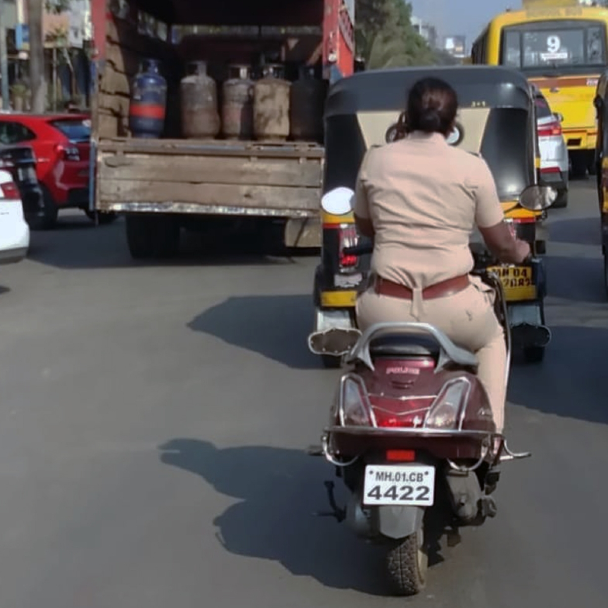Policing the Police: Caught on camera, lady cop fined for helmetless riding