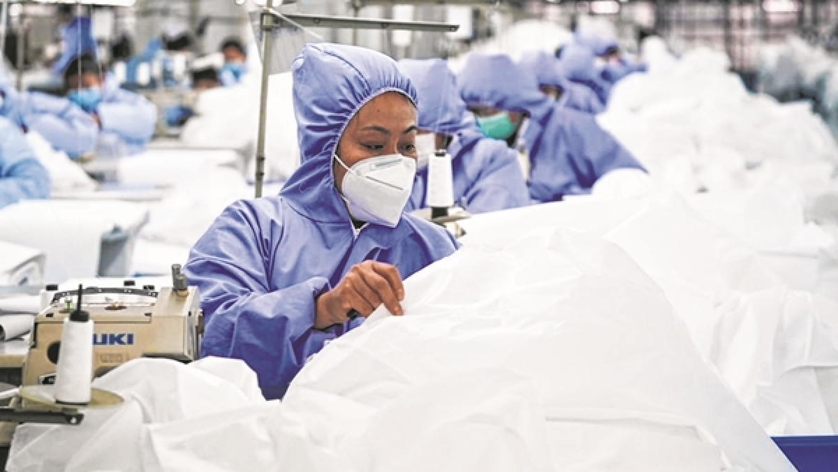 Workers make general protective suits at Hongdou Industrial Co, Ltd. in Wuxi, east  China's Jiangsu Province.