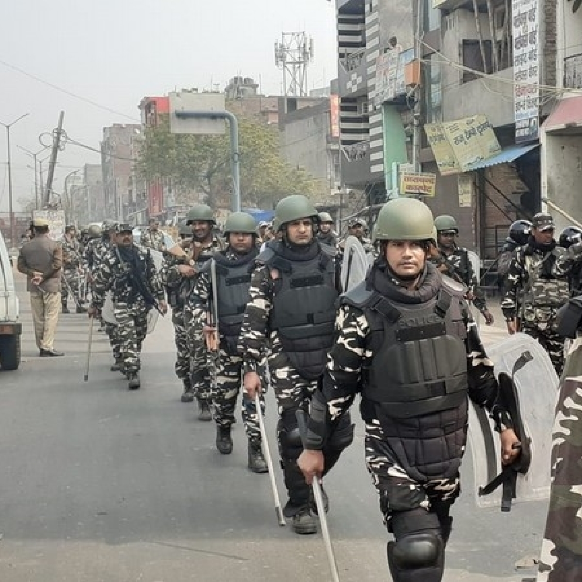 Delhi violence: Security personnel conduct flag march with riot gears and batons in Babarpur