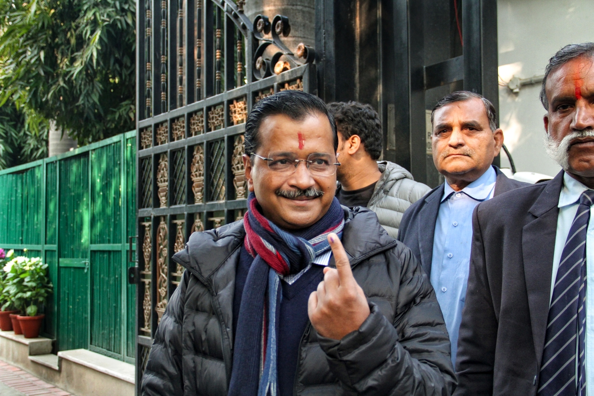 New Delhi: Delhi Chief Minister and AAP convenor Arvind Kejriwal shows his inked finger as he emerges from a polling station in the Civil Lines area after casting his vote for the Assembly elections, in New Delhi, Saturday, Feb. 8, 2020.