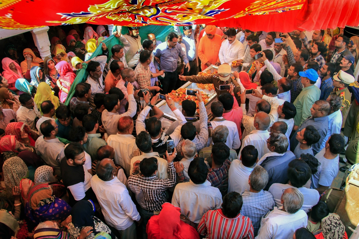 People pay their last respects to the mortal remains of slain Delhi police head constable Ratan Lal, who was killed during communal riots over the amended citizenship law in east Delhi area, in Sikar district of Rajasthan, Wednesday, Feb. 26, 2020.