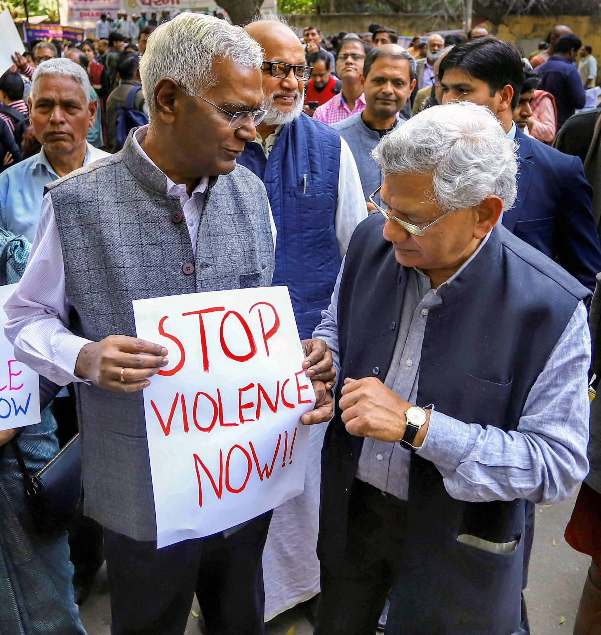 General Secretary of Communist Party of India (CPI) D Raja and CPI(M) general secretary Sitaram Yechury stage a peaceful protest in view of the recent violence in riot-affected areas of east delhi, in New Delhi, Wednesday, Feb. 26, 2020.