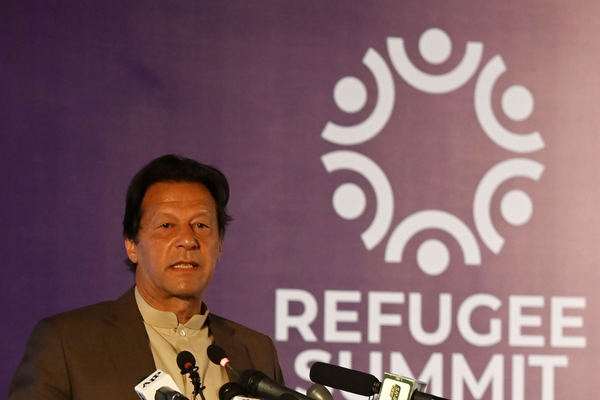 Pakistan's Prime Minister Imran Khan delivers a speech during the Refugee Summit Islamabad to mark 40 years of hosting Afghan refugee in Islamabad on Monday.