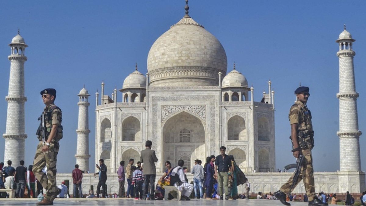 Security personnel patrol the premises of Taj Mahal ahead of US President Donald Trump's visit