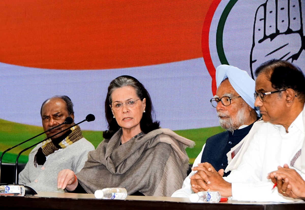 Congress Interim President Sonia Gandhi addresses a press conference along with former Prime Minister Dr. Manmohan Singh, and Former Defence Minister AK Antony in New Delhi on Wednesday.