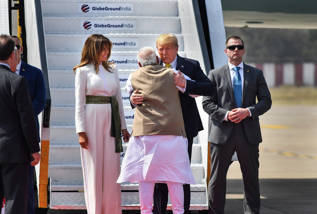Ahmedabad: Prime Minister Narendra Modi greets US President Donald Trump with a hug as First Lady Melania Trump looks on, upon their arrival at the Sardar Vallabhbhai Patel International Airport in Ahmedabad, Monday, Feb. 24, 2020. Trump is on a two-day visit to India.
