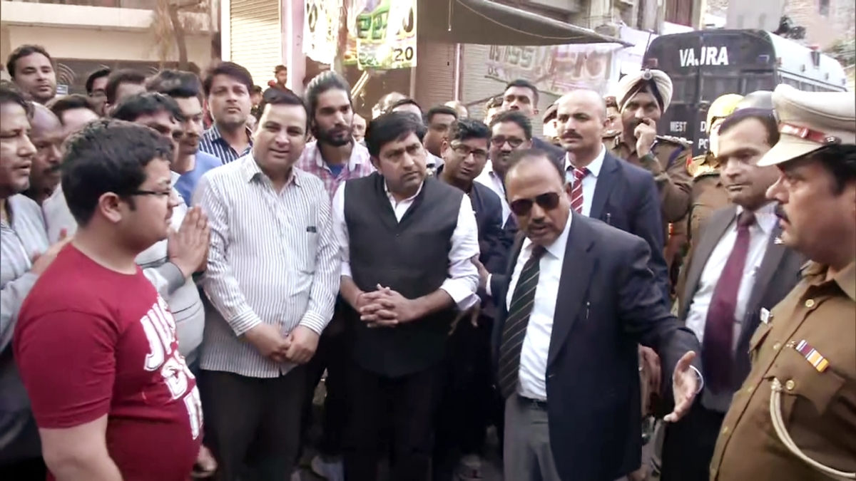National Security Advisor (NSA) Ajit Doval interacts with the local residents of Maujpur, in New Delhi on Wednesday.