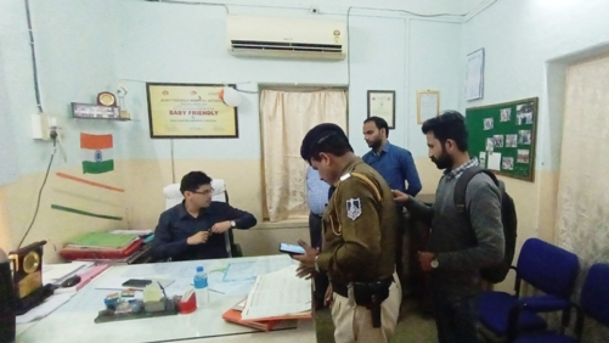 Collector checking attendence register