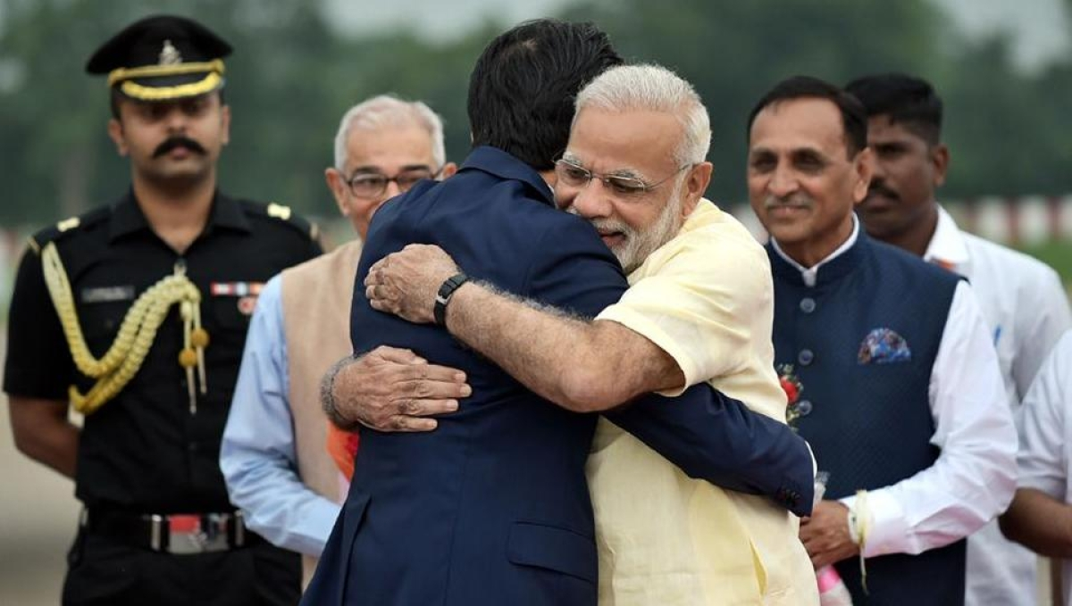 Narendra Modi hugs Shinzo Abe at Ahmedabad airport