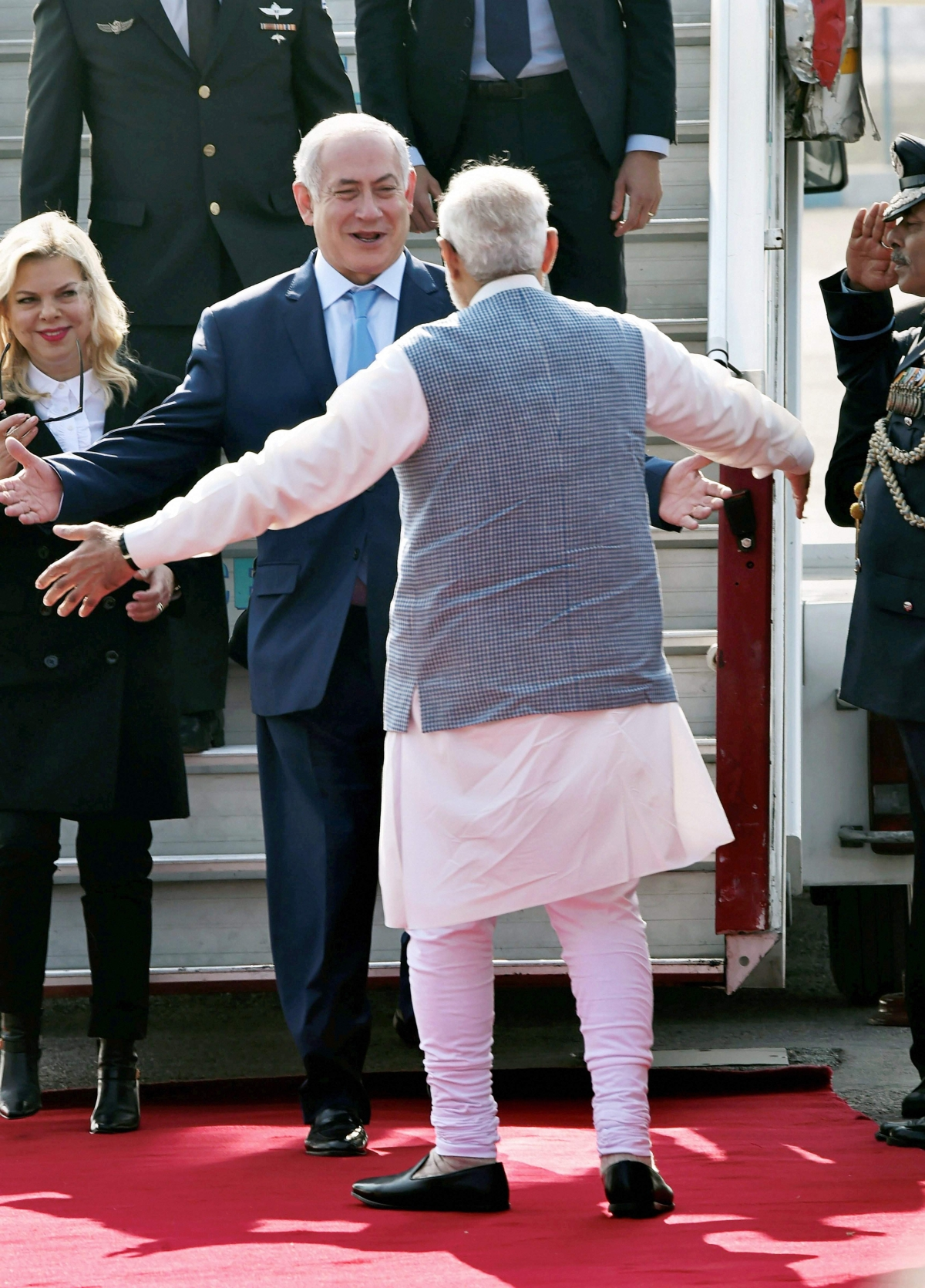 Prime Minister Modi broke protocol to personally receive  Benjamin Netanyahu with a hug as he arrived in India for a six-day visit. He also shook hands with Netanyahu's wife Sara.