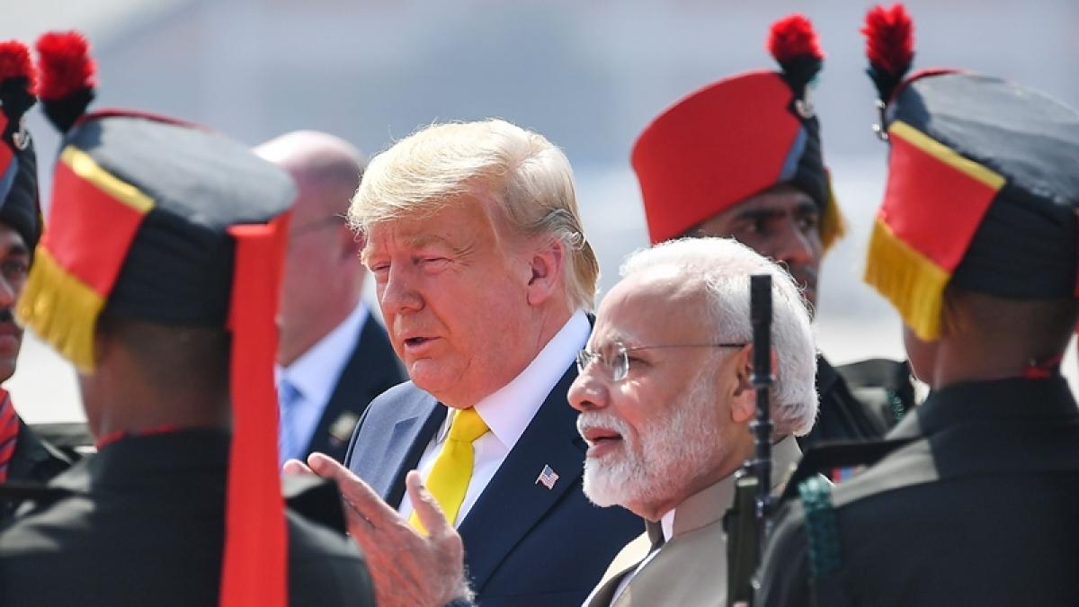 India's Prime Minister Narendra Modi (2R) greets US President Donald Trump upon his arrival at Sardar Vallabhbhai Patel International Airport in Ahmedabad
