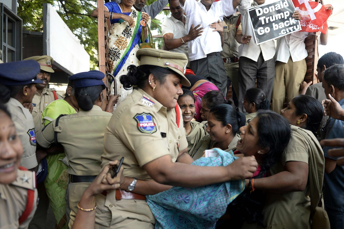 Police personnel detain an activist of the Centre of Indian Trade Unions (CITU) during a protest against US President Donald Trump's visit to India in Hyderabad on February 24, 2020