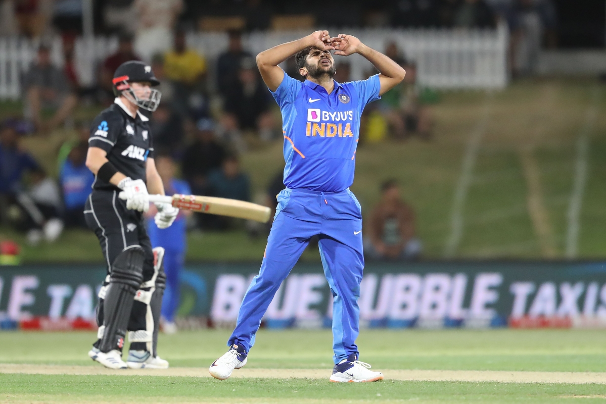 Shardul Thakur (R) reacts after bowling during the third one-day international cricket match between New Zealand and India at the Bay Oval in Mount Maunganui on February 11.