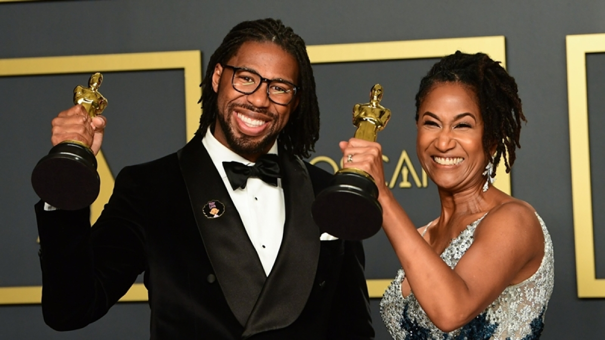 "US director Matthew A. Cherry and Karen Rupert Toliver poses in the press room with the Oscar for Best Animated Short Film for ""Hair Love"""