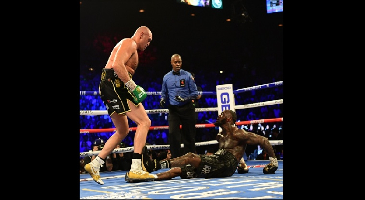 Tyson scores furious TKO against Deontay Wilder to win WBC title