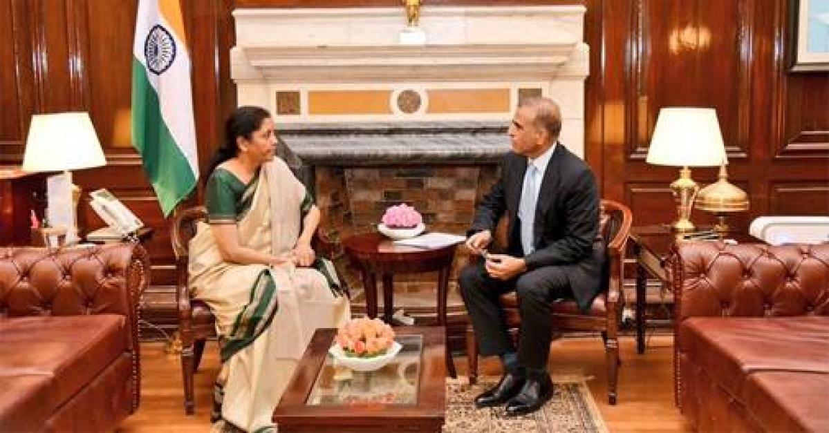 Bharti Airtel chairman Sunil Mittal with Finance Minister Nirmala Sitharaman (L)