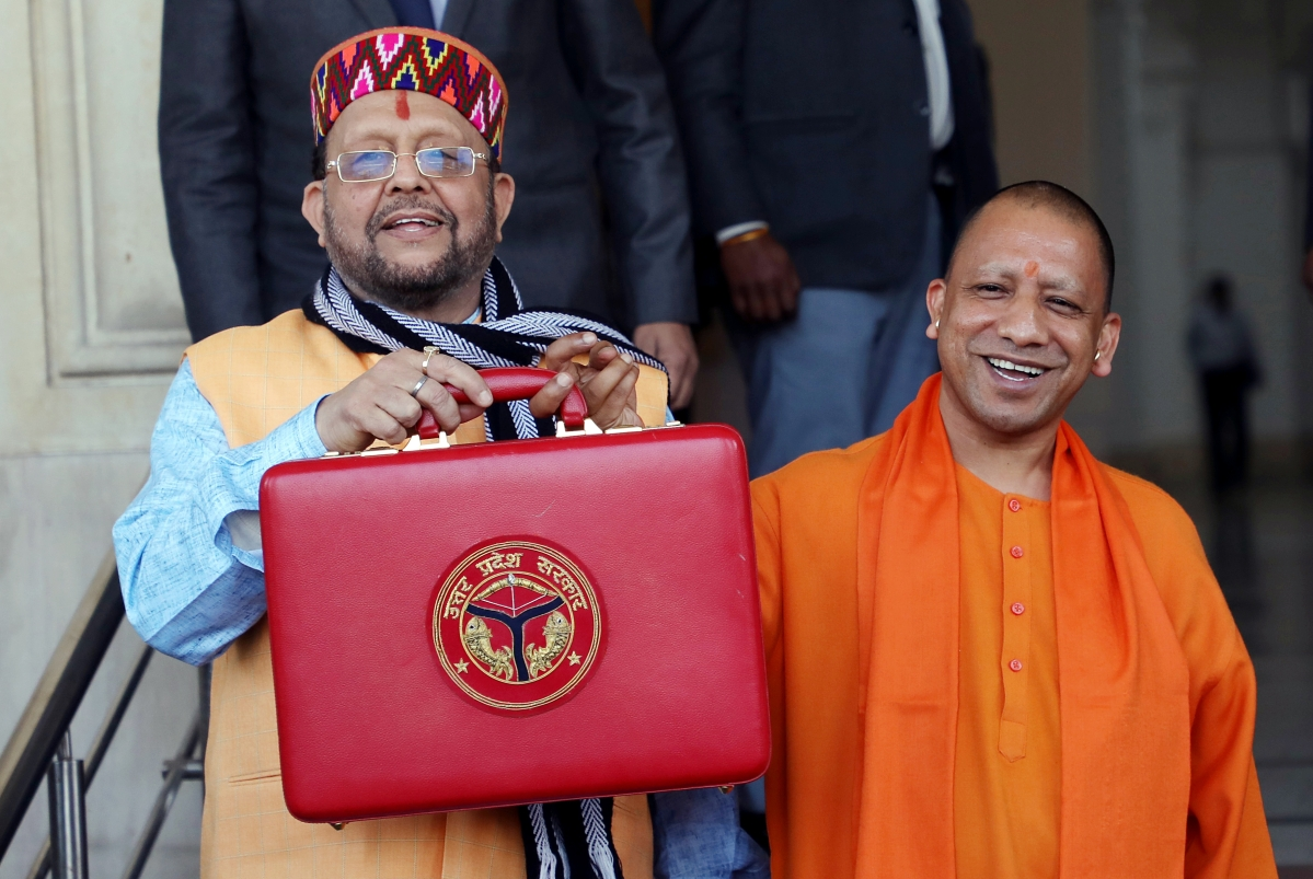 Uttar Pradesh Chief Minister Yogi Adityanath  and Uttar Pradesh Finance Minister Suresh Khanna before the presentation of State Budget 2020-21 in the UP Legislative Assembly, in Lucknow on Tuesday.