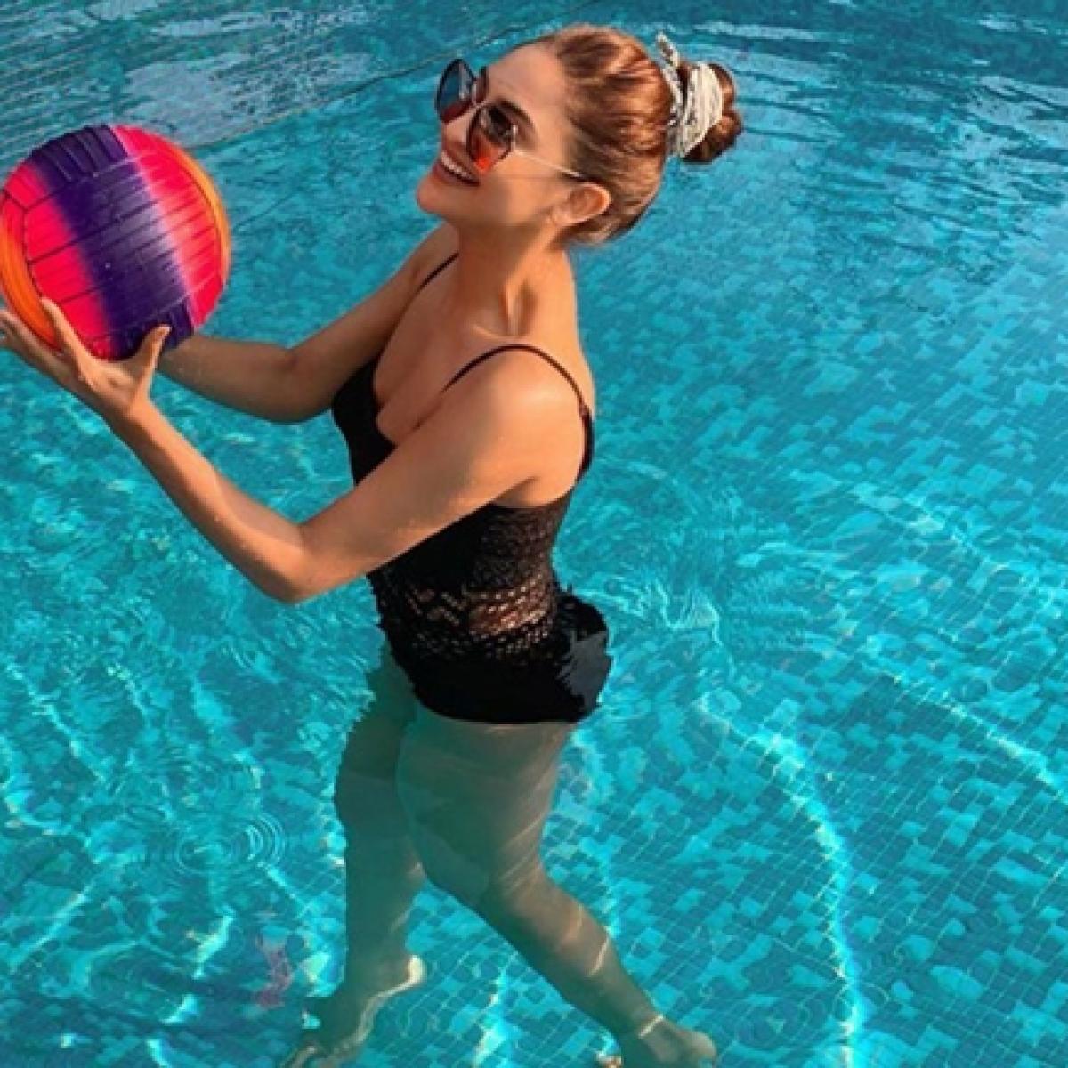 Krystle D'Souza sends temperature soaring in a black monokini