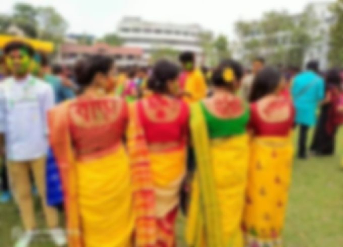 Rabindra Bharati University  girls wearing sarees wrote these words on the back