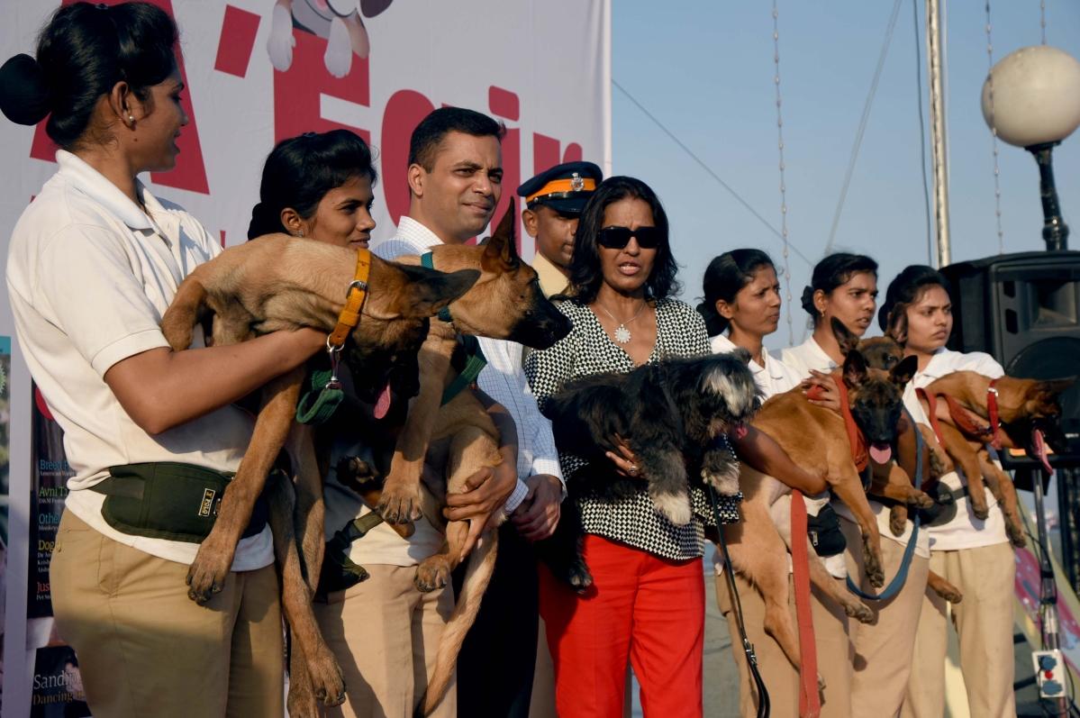 Mumbai Police carrying pet dogs.
