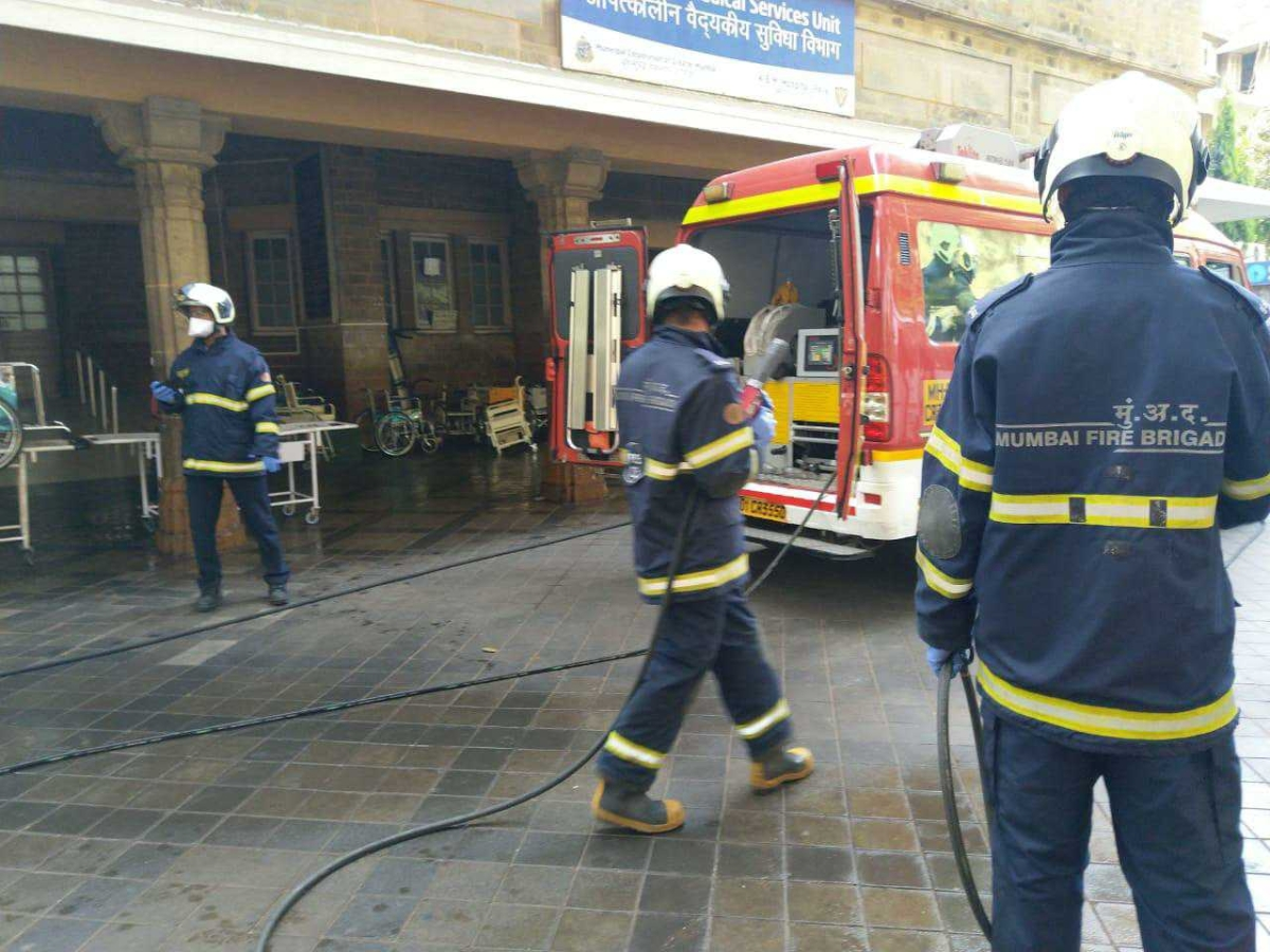 Mumbai Fire Brigade staffer begin the sanitisation work at KEM Hospital