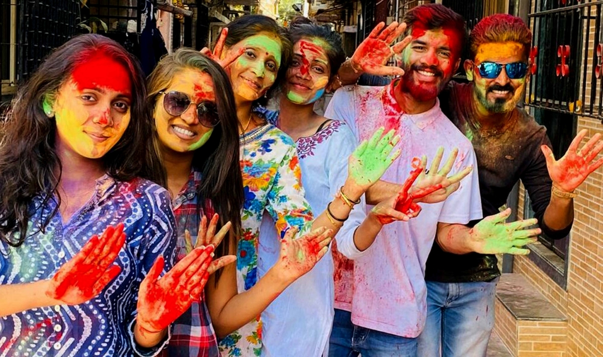 People celebrate Holi at Gorai in Mumbai's Borivali