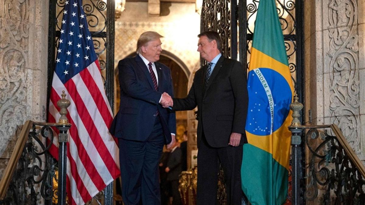 Brazilian President Bolsonaro's press secretary tests positive for coronavirus days after meeting Donald Trump