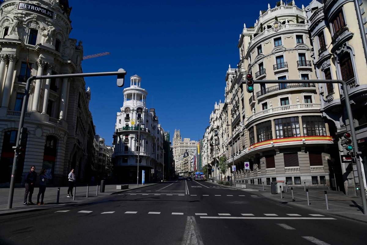 Gran Via remains empty in Madrid after regional authorities ordered all shops in the region be shuttered in order to slow the coronavirus spread.