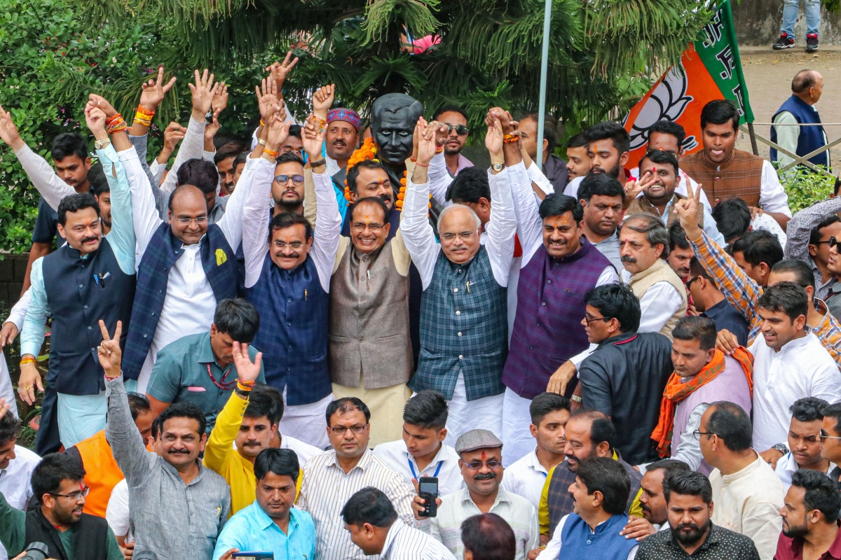 BJP leaders Shivraj Singh Chouhan, VD Sharma, Gopal Bhargava and others celebrate after Madhya Pradesh Chief Minister Kamal Nath resigned from his post, at state party headquarters in Bhopal, Friday, March 20, 2020.