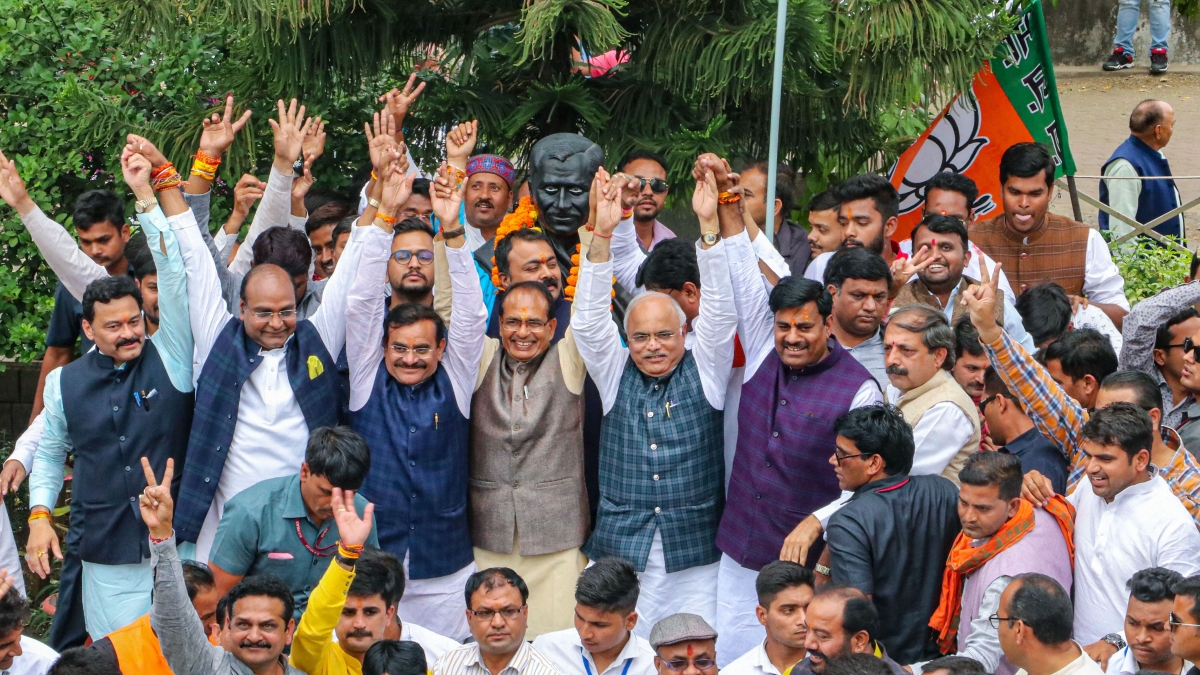 BJP leaders Shivraj Singh Chouhan, VD Sharma, Gopal Bhargava and others celebrate after Madhya Pradesh Chief Minister Kamal Nath resigned from his post, at state party headquarters in Bhopal, Friday, March 20, 2020. File Photo