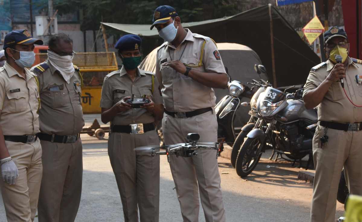 Mumbai Police flying a drone to send their message to people.