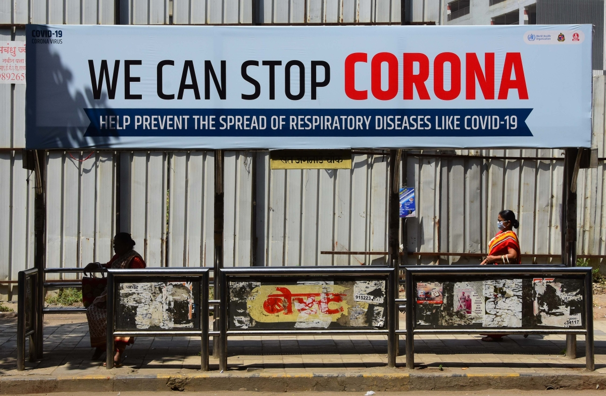 A bus stop reads a message to avoid coronavirus spread.