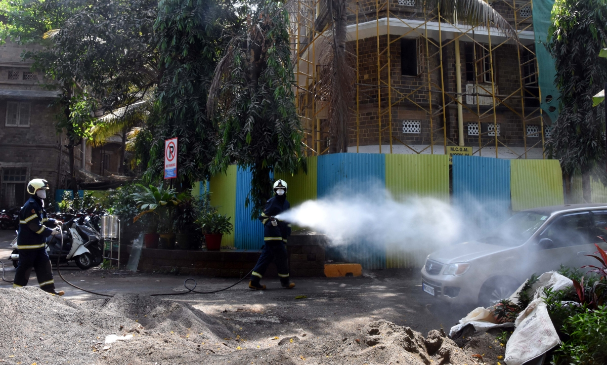 Mumbai fire brigade personnel sanitize area outside KEM Hospital