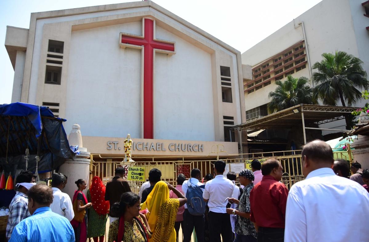 Devotees offer prayers outside St. Michaels Church
