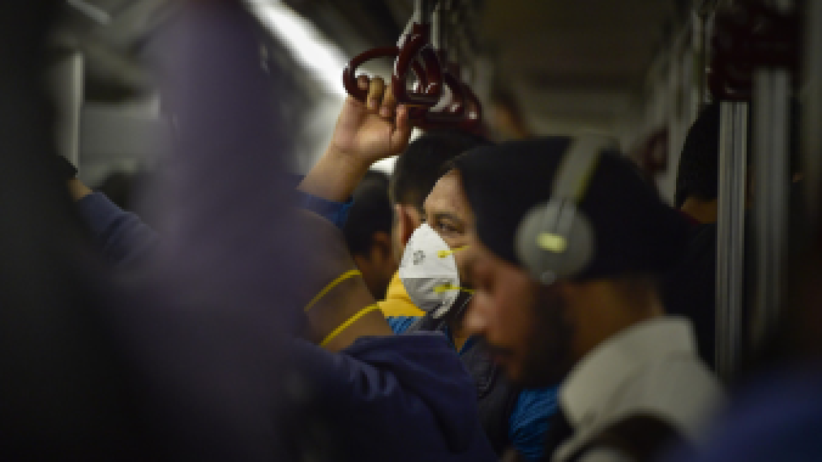 A commuter wears protective mask in wake of the deadly novel coronavirus, while travelling in a metro.