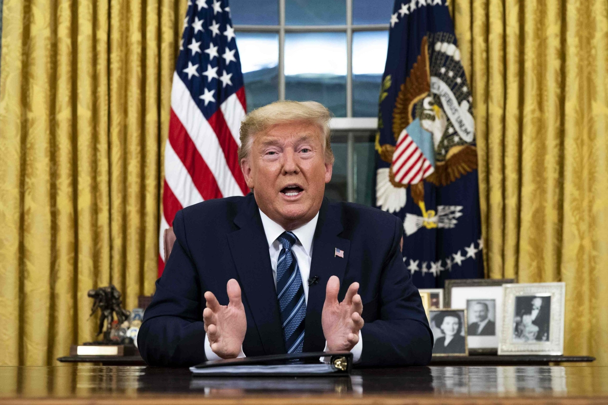 President Donald Trump speaks in an address to the nation from the Oval Office at the White House about the coronavirus Wednesday,  in Washington.
