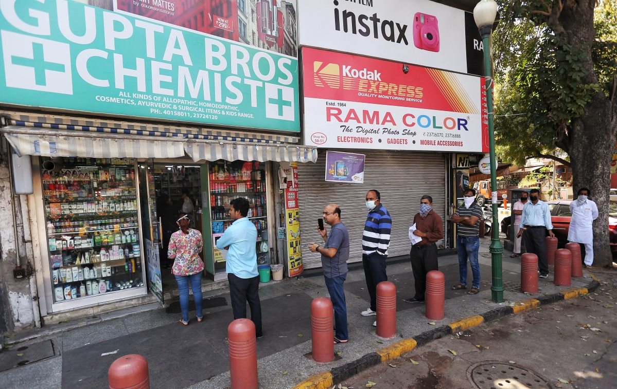 Social distancing was seen as people standing in a queue outside a medical store at Bengali Market in New Delhi on Wednesday.