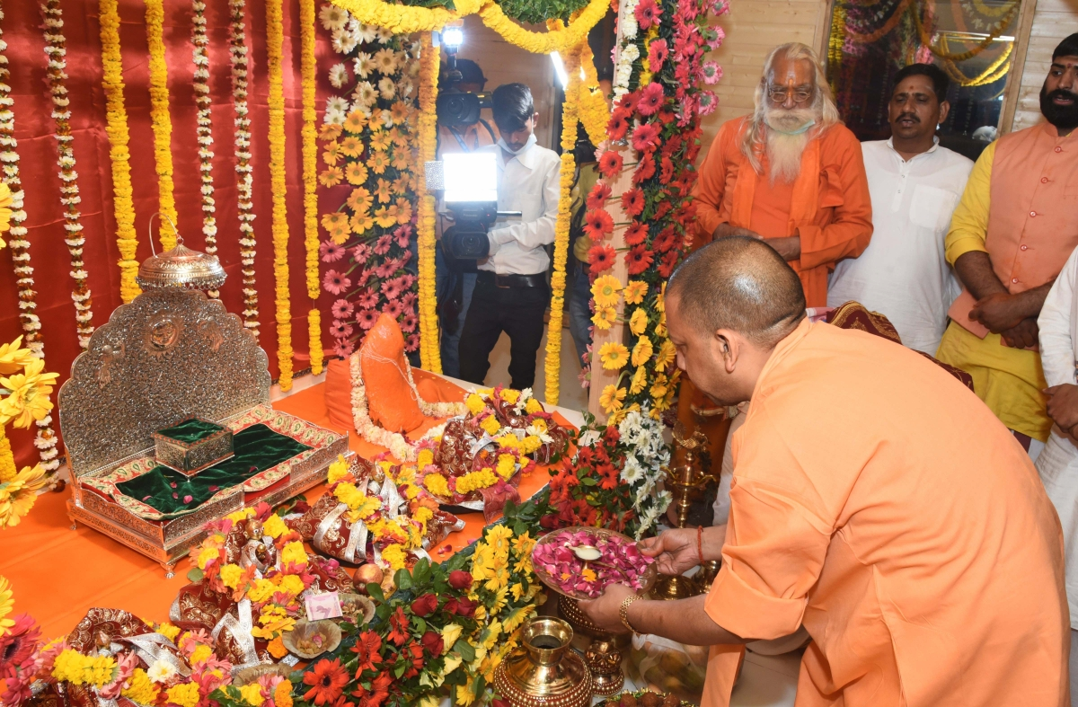 Uttar Pradesh Chief Minister Yogi Adityanath offers prayers at Asthai Temple in Ayodhya, Wednesday, March 25, 2020. Social distancing was maintained as the CM shifted the idol of Ramlala from the makeshift temple to a new structure near Manas Bhawan, in Ayodhya. There was no participation of the public.