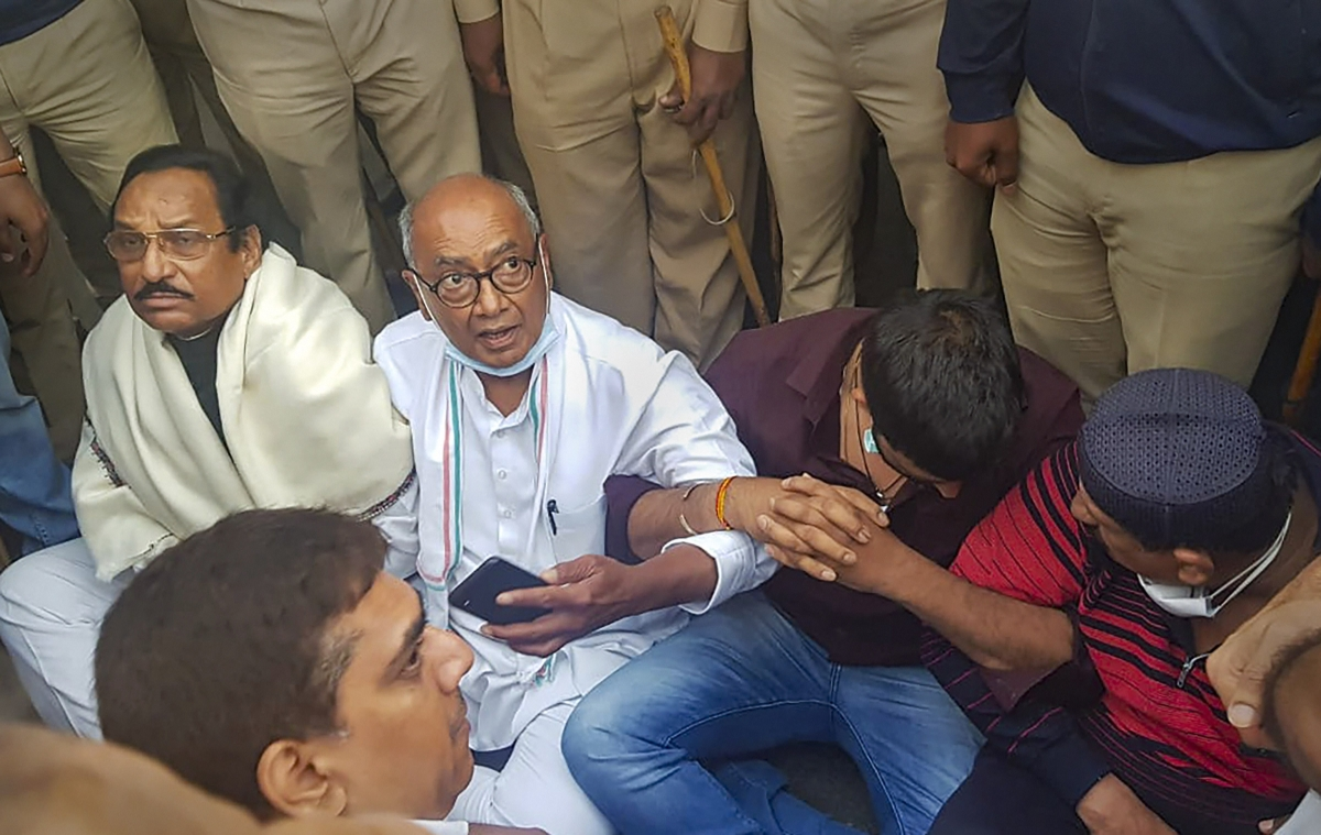 Congress leader Digvijaya Singh sits on a dharna near Ramada hotel after he was allegedly not allowed by police to visit Madhya Pradesh Congress MLAs lodged at the hotel, in Bengaluru.