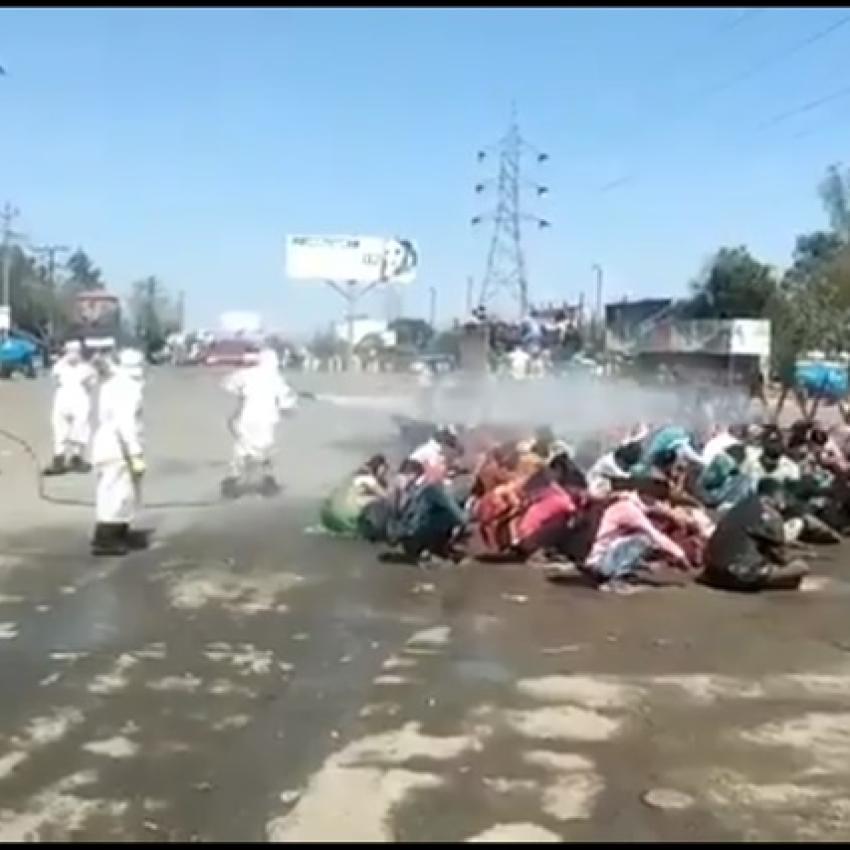 'Who are you trying to kill, coronavirus or humans?': Video of UP authorities spraying chemical solution on migrants goes viral; Twitter reacts