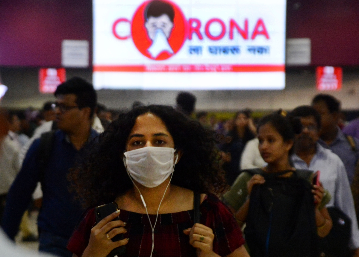 Railway Passengers wearing a mask for preventing measure to save from Corona Virus at Churchgate Station