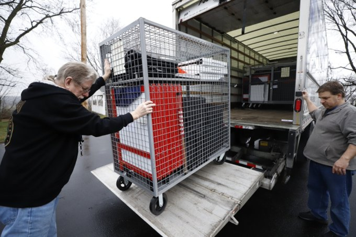 Voting machines are collected from a polling place at Our Lady of Lourdes church in Wintersville, Ohio, Tuesday, March 17, 2020. Ohio's presidential primary was postponed Tuesday amid coronavirus concerns.