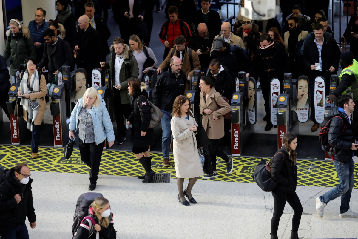 Commuters make their way through Waterloo station at rush hour, as the number of coronavirus cases grows around the world, in London on Monday.