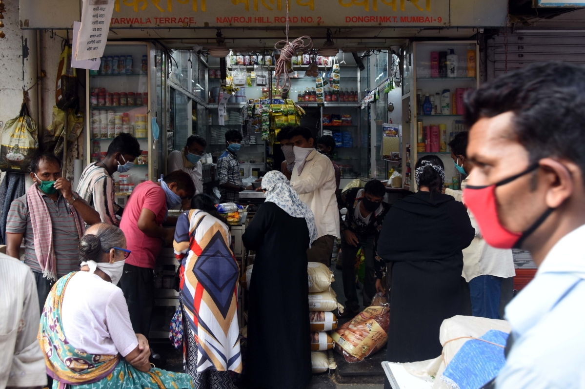 Customers come out to buy daily essentials at a provisional store in Dongri.