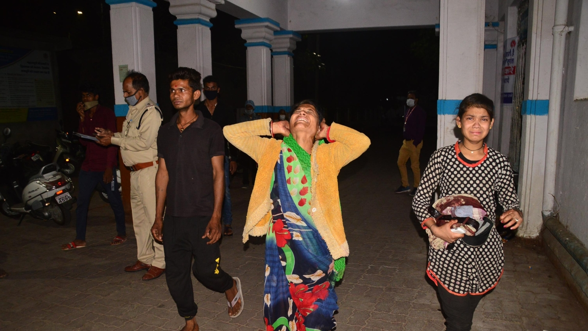 Weeping members of deceased coming out of Civil Hospital, in Ujjain on late Monday.