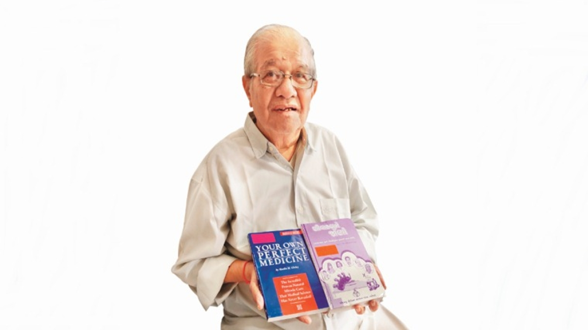 Dinesh Doshi with books on urotherapy