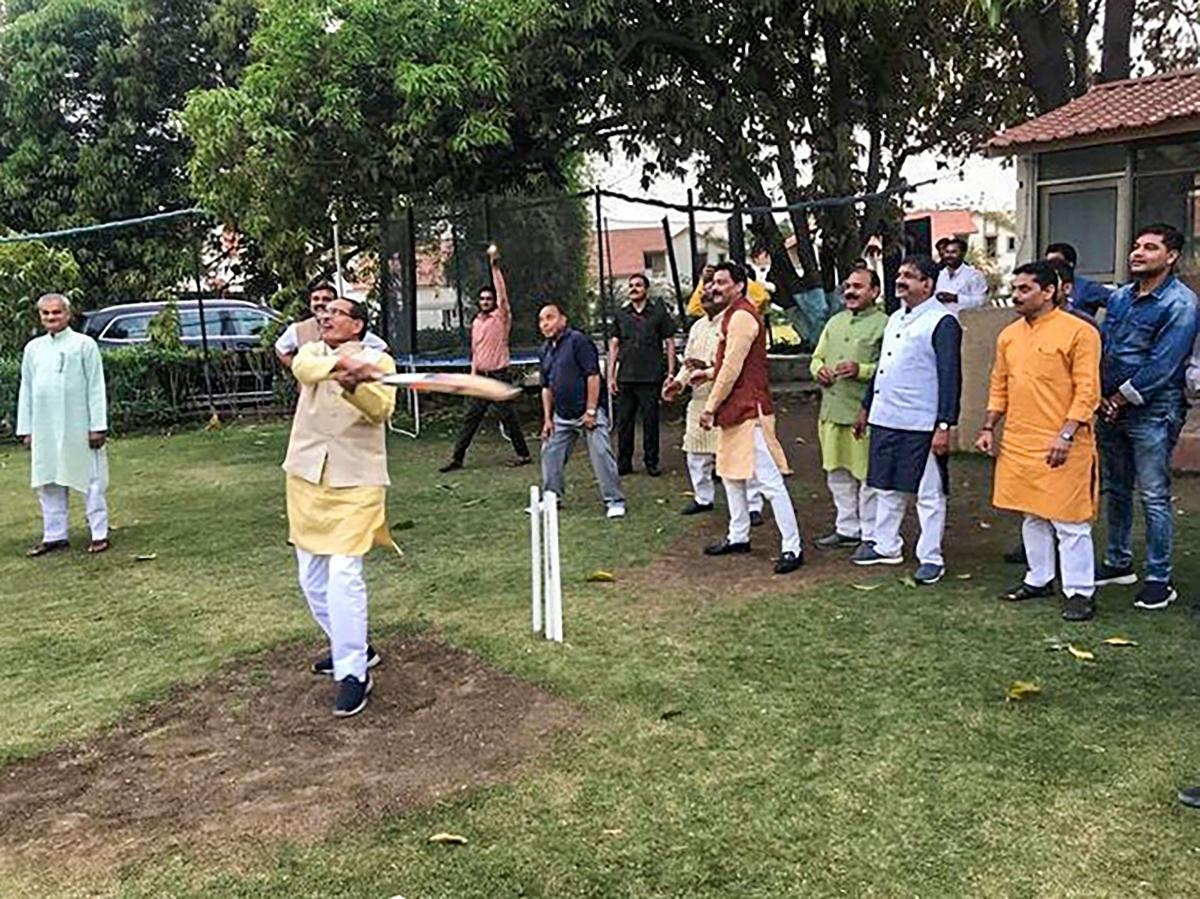 BJP leader Shivraj Singh Chouhan plays cricket amid Madhya Pradesh political turmoil, in Bhopal on Wednesday, March 18, 2020.
