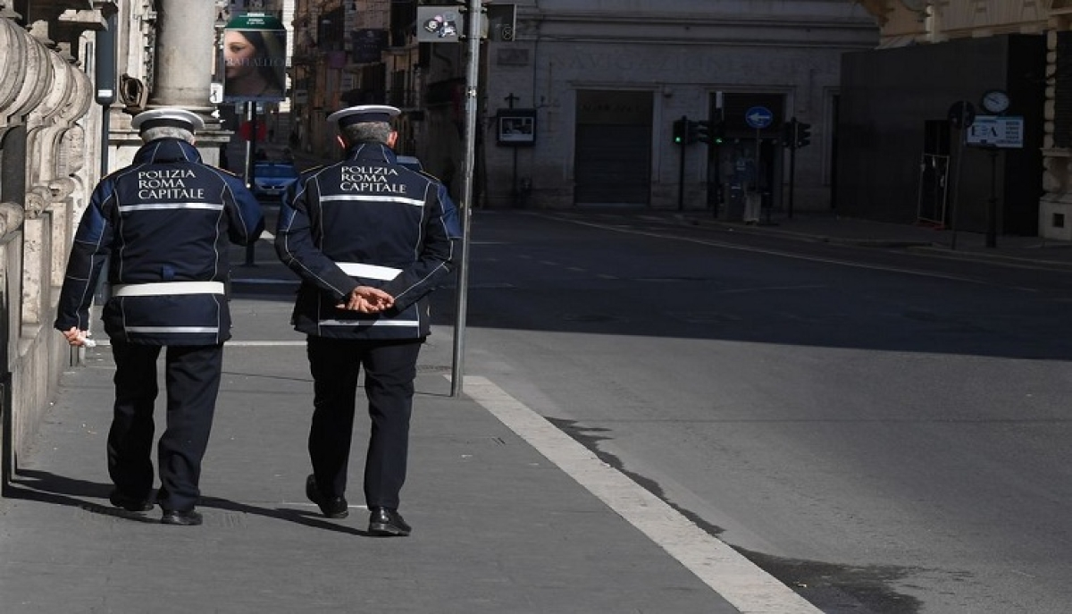 Policemen walk on a street in Rome, Italy, on March 18, 2020.