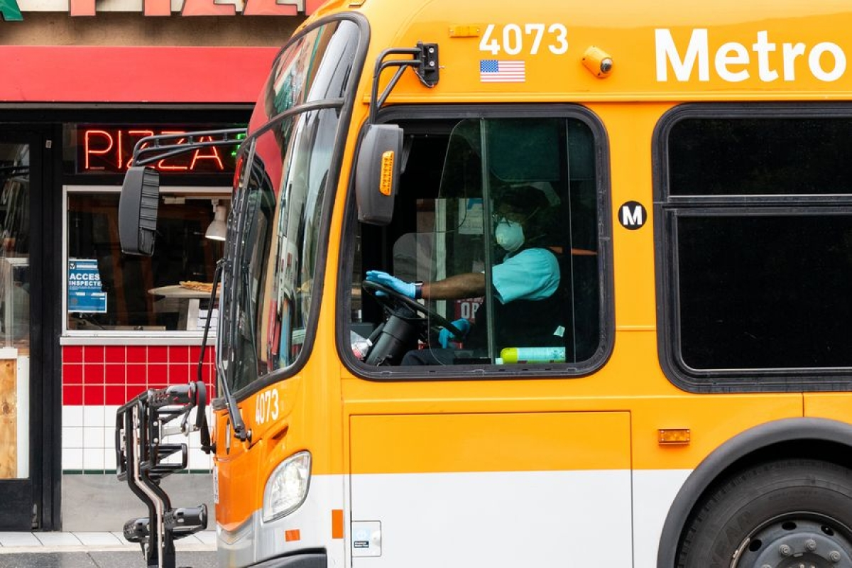 A bus driver wearing a face mask is seen in Los Angeles, California, the United States, March 20, 2020.