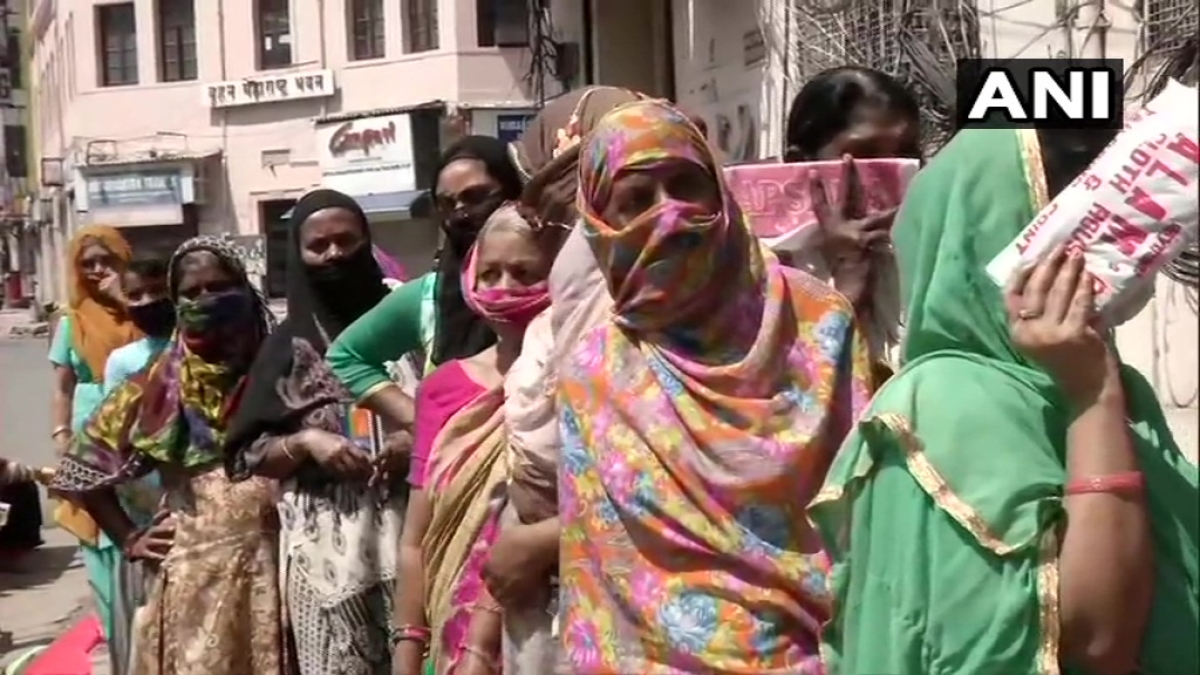Women standing in a queue outside a bank in Delhi's Paharganj refused to maintain social distancing and were dispersed by police personnel. They later reassembled keeping distance after Police assured them that banks and ATMs will remain open.